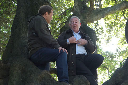 Comedian Ardal O'Hanlon with Paul Clerkin, a local tree expert in Co Down, sitting up the 200-year-old Holm Oak tree.
