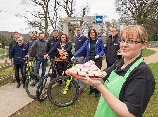 Celebrating the success with business owners is Newry, Mourne and Down District Council Chairperson Councillor Gillian Fitzpatrick and Chain Reaction Cycles representatives Neil McGuigan and Aaron Kearney.