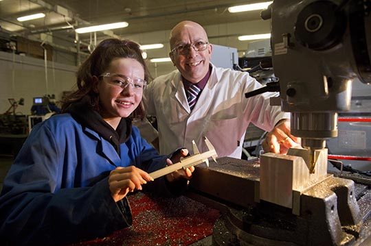 Celebrating vocational education: SERC engineering student Chloe Pollock from Ballynahinch is just one of a handful of young women across the province pursuing a career in the male dominated engineering industry and is one of only two females in her class. Chloe is pictured with tutor Joe Neeson.