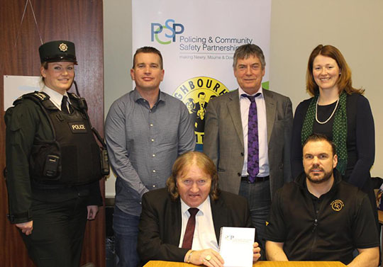 L to R Standing - Sgt Kelly Gibson, PSNI,  Inspector Nigel Henry, PSNI, Owen McDonnell, Housing Executive South Down Area Manager and Siobhan Fearon PCSP Manager, Newry Mourne and Down area. Seated front Cllr Brian Quinn Chairperson of PCSP, and Shane Fay, Elite Security (Community Safety Warden Team) .