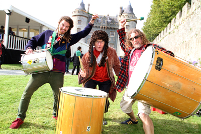 Joe McCardle and Paul Taylor of the Streetwise Circus Samba Band with Sir Hans Sloane aka Clive Scoular let loose of the drums at last year's Chocolate Ball celebrations.