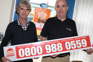 Down District Councillor Eamonn Mac Con Midhe with Bryson Energy representative Chris Glass calling of Downpatrick householders who may be on benefits or entitled to them to avail of the Warm Homes Scheme.