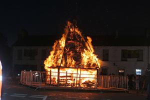 An eco-bonfire blazes.
