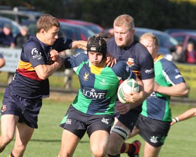 Hinch's Neil Faloon battles against the Banbridge defenders.
