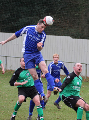 Peter Telford using his head for Kilmore Rec scores a crucial goal.