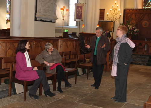 Theresa Villiers, NI Seceratary of State and South Dowm MP Margaret Ritchie with Dean Henry Hull and the Downpatrick Catherdral Church Warden,  Joyce Wilkonson, talk about the history of the church.