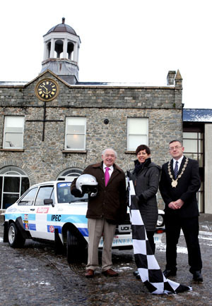 Lisburn City Council Economic Development Committee chairperson Alderman Jim Dillon, rally driver Caroline Spers and Down District Council chairperson Councillor Mickey Coogan in teh Market Square in Ballynahinch launch the Easter Stages Rally. (Picture by Matt Mackey/presseye.com) Chairman of Lisburn City Council's Economic Development Committee Alderman Jim Dillon, rally fan Caroline Speers, and Councilor Mickey Coogan, Chairperson of Down District Council, pictured in Ballynahinch to celebrate the launch of the Easter Stages Rally which takes place on Saturday, 30th March. Up to 120 cars are expected to take part in the rally which will cover twelve stages and over 100 competitive miles between Lisburn and Ballynahinch. It will feature as Round 2 of the Irish Tarmac Rally Championship and Round 3 of the Northern Ireland Stage Rally Championship.