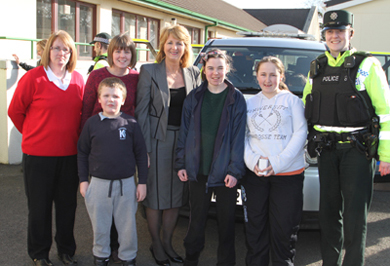 Pupils of Knockevin School in Downpatrick pictured with classrom assistant Alison Synott, teacher Christie Clarke, school principal Ann Cooper and Constable Caroline Owens, Downpatrick Neighbourhood team.