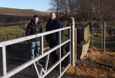 Councillor Stephen Burns and Sinn Féin representative Brian Morgan at the new gate at Lough Island Reavey.