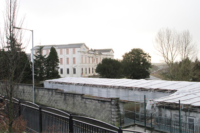 The old Downe Hospital in Downpatrick with theformer St John's residential Home in the foreground which was destroyed in 2012 in an arson attack.