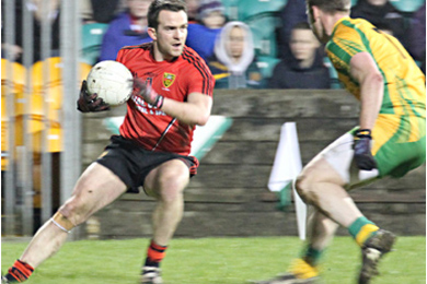 Mark Poland battling for Down against Donegal..