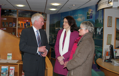 John Carson, Chairman of the St Patrick Centre in Downpatrick, in the Tourist Information Centre, chats to the Secretary of State Rheresa Villiers MP and South Down MP Margaret Ritchie.