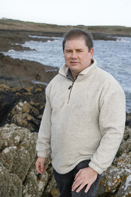 Down Councillor Cadogan Enright pictured beside the sewage outfall at Sheepland north of Ardglass.
