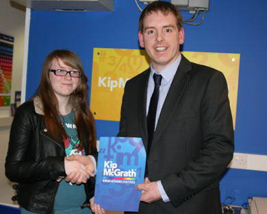Megan Rafferty receives her award and is pictured with Kip McGrath Craigavon Centre Manager, Michael Rooney.