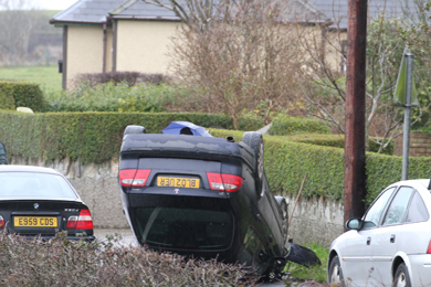 A black Saab turned on it roof on the Strangford Road just outside Ardglass.