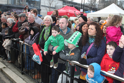 A section of the crowd looks on as the parade passes by in Downpatrick.