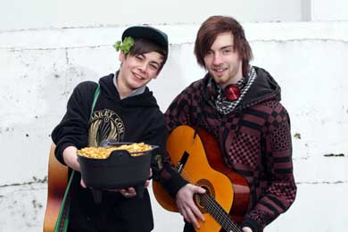 SERC Art and Design students Ryan Meehan and Peter Jones from Castlewellan tune up for the street music session in Downpatrick during the St Patrick Festival. (Photo by Darren Kidd/Presseye).