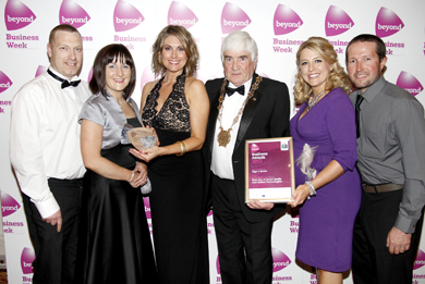 Deirdre McLaughlin, owner of Sin2Music, second left, pictured receiving  an award at the Beyond Down Business awards last year.