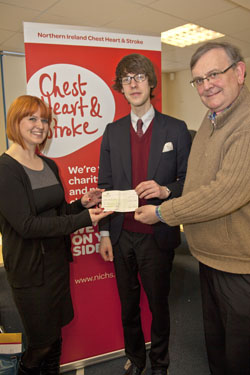 Vanessa Elder, NICHS with Michael Fisher, vice-chairman of the Belfast NUJ branch, present a cheque to Iain McDowell, the winner of this year's Paul Robinson bursary. (Photo by Kevin Cooper/Photoline).
