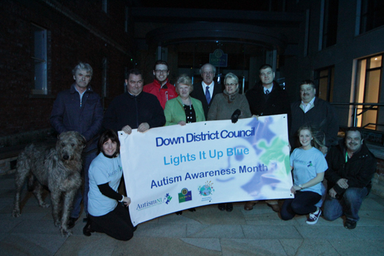 The Down Civic Forum is lit up blue in support of Autism NI - Included are, from left, Down District Councillors Eamonn mac Con Midhe, Terry Andrews, Gareth Sharvin, with Strangford MP Jim Shannon and South Down MP Margaret Ritchie, and Councillors Colin McGrath, Billy Walker and Liam Johnston. Pictured front row are Audrey Mullan and Rachel Gribben of Autism NI.