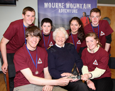 Dame Mary Peters with the Down High School B team: Pictured are Edward Rush, Jenny patterson, Michael McDowell, Sophie baninji, Stewart Burns and Adam Brown.