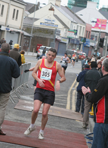 A keen runner. EDAC Stephen Shannon pictured coming in with a good time in the 2011 Jimmy's 10K in Downpatrick.