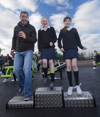 Ex Ireland and Ulster rugby player Andy Ward puts Ballynahinch High School pupils  Megan Tate and Hannah-Jane Hitchins through their paces at the new outdoor gym.  (Photo by Brian Morrison.)