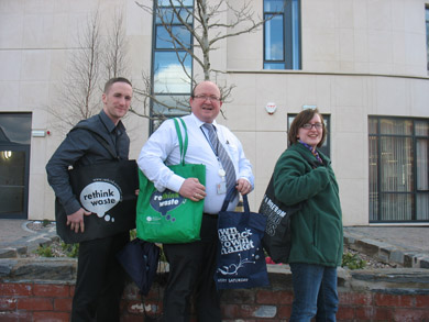 Barry Treacy, Joe Parkes and Lucinda White show off the reusable bags that Down District Council are giving away to shoppers.