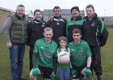 The Senior Football Team Shirt presentation.  Sponsors were the McGrady family, back L to R; Rory McCabe Chairman, Secretary Brian Dougherty, team trainer Barney Cunningham, team manager 'Shorty' Treanor and Damien McGrady. Front Row captain Liam McKibben and Barry Travers with Damien's son Ryan McGrady.