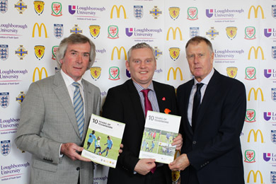 John McCallister MLA, centre, joins the launch of the McDonald's soccer report at Stormont.