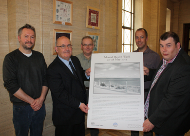 Representatives from Action Mental Health and Seacourt Print Workshop with the Speaker of the Northern Ireland Assembly, Mr William Hay MLA, at the launch of an exhibition to mark Mental Health Week.
