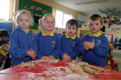Pupils of Ardglass Community Playgroup j=having fun at the play-do table.