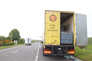 A rear view of the trailer showing the square containers with the waste fuel.