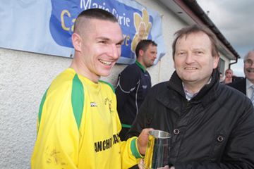 Killough's Freddie O'Connor is Man of the Match and receives his trophy from David Martin, IFA Council member.