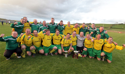 Killough FC celebrate after winning the Harry Clarke Cup.