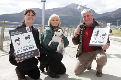 Councillors Carmel O'Boyle and Eamon O'Neill with Down District Council dog warden have launched the new rules about looking after your dog on Newcastle promenade and beaches.