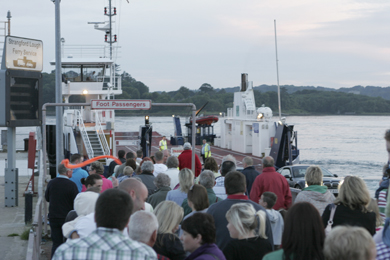 Portaferry is a popular tourist destination in County Down. Pictured are visitors returning across Strangford Lough after a festival gala parade.