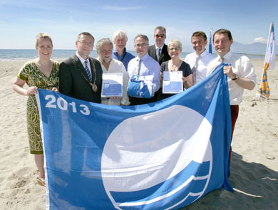 Down Blue Flag (L-R): Lynsey McCloskey, Campaign Manager, TIDY Northern Ireland; Cllr Michael Coogan; Simon Boyle, Warden, Down District Council; David Thompson, Coast and Countryside Manager, Murlough Beach, The National Trust; Environment Minister Alex Attwood; Michael Lipsett, Director of Recreation, Down District Council; Margaret Ritchie, MP for South Down; Conal Stewart, Northern Ireland Tourist Board & Ian Humphreys, Chief Executive, TIDY Northern Ireland