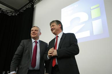 John McCallister and Basil MacCrea with their NI 21 party logo in the background.