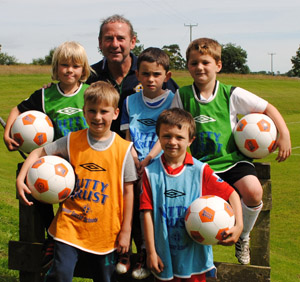 IFA Grassroots Coach Seamus Heath with some soccer stars of the future.