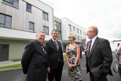 Colm McKenna, South Eastern HSC Trust Chairman, Health Minister Edwin Poots, Cedar Grove Manager and Ian Kirkpatrick, Chairman of Trinity Housing, chat outside the new £3.8 facility in Downpatrick.