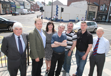 The Dereliction Fund has improved the centre of Downpatrick. Pictured are Councillors Dermot Curran, Cadogan Enright, Eamonn Mac Con Midhe, Liam Johnston, Colin McGrath, and John Doris with Council Project Development Officer Margaret Quinn.