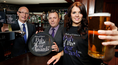 Model Fional Guinnane joins Mark Stewart, chairman of Pubs of Ulster and Colin Neill, chief executive of Pubs of Ulster, to launch Pubs of Ulster's Pub of the Year Awards 2013.