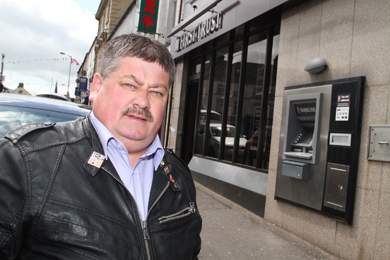Rowallene Councillor Billy Walker is concerned at the proposed closure of the Ballynahinch First Trust Bank branch on 4 October.