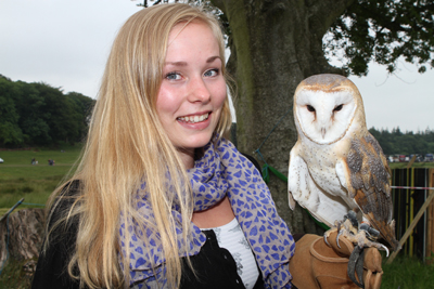 Twit-to-woo. Helga Lindheim from Norway makes friends with Alba the barn owl.