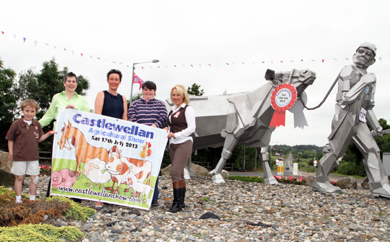 Young James McCauley gets a helping hand from  Fidelma Carolan, Show Marketing Officer, Jackie Fitzpatrick, Show Secretary, Alex Woods, committee member and Michelle McCauley, Castlewellan Show Chairperson for the final promotion for this Saturday's annual event.