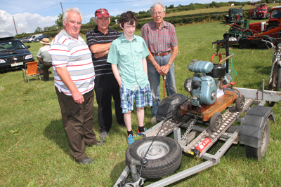 Barney Feenan, Natie Connor, Raymond Lundy and james Logam look over a JAP pump at the Claragh Bridge show.