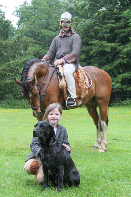 Katelyn Thomas (8) whose dad is gamekeeper at Ballydugan Estate is pictured with her working dog, Minnie, at the Shane's Castle Game Fair.