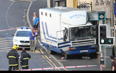 The horse trailer jammed against the front of the Downe in the Mouth dental practice in Irish Street in Downpatrock.  A mother and baby were trapped below the runaway vehicle.
