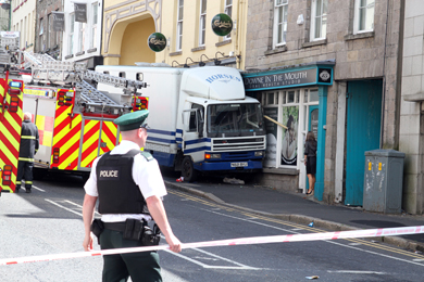 The scene in Irish Street in Downpatrick where a horse trailer crashed into a dental practice.